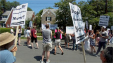Protesting an evicting slumlord at his Cleveland Park home