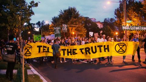 Demonstrators Gather at Brazilian Embassy to Mourn, Protest